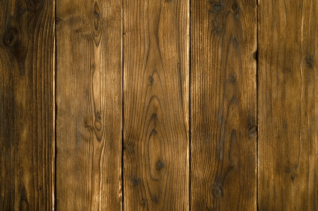 Sfondo astratto di tavole di legno scuro. vista dall'alto del primo piano per le opere d'arte.