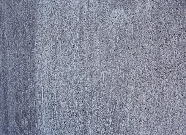 Sfondo astratto dalla vecchia struttura di cemento grigio con grunge e sfondo vintage graffiato