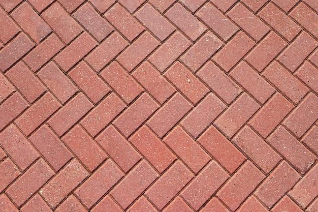 Sfondo astratto dalla pavimentazione di tegole rosse, mattoni.