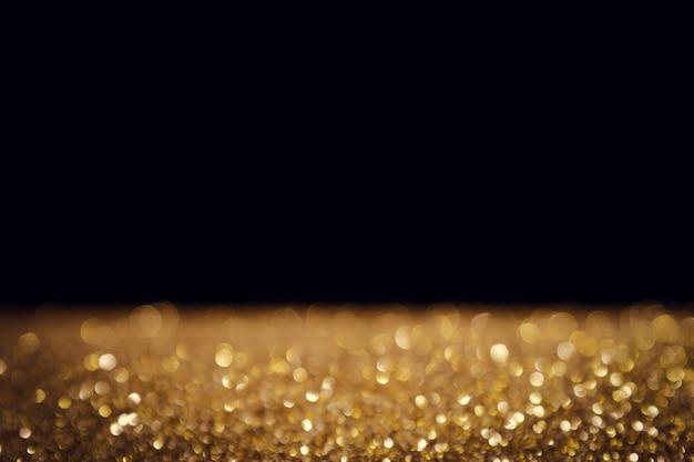 Festa di natale del bokeh della luce dell'oro astratto del fondo