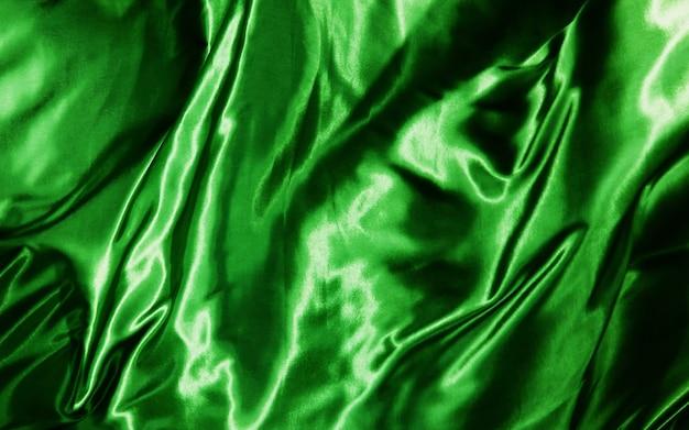 Sfondo astratto seta verde o tessuto di raso trama