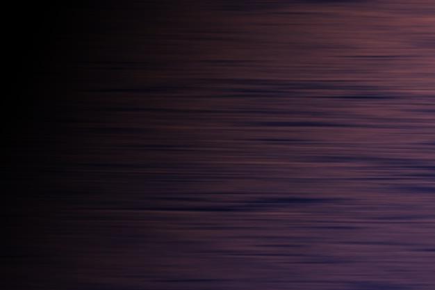 Sfondo astratto. righe orizzontali con blackout a sinistra. trama scura.