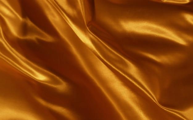 Astratto sfondo arancione di seta o tessuto di raso trama