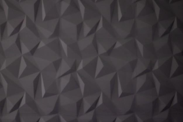 Sfondo astratto di poligoni su grigio