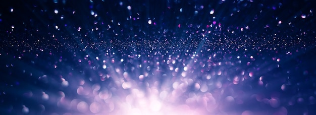 Sfondo astratto di luci glitter viola e nero