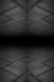 Fondo astratto del muro di mattoni nero strutturato.