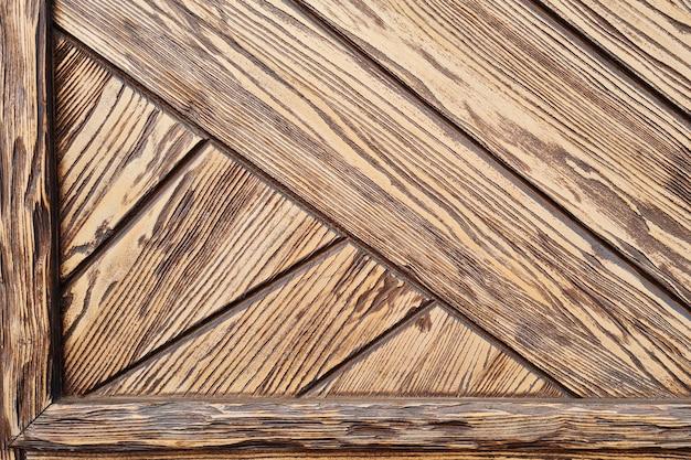 Fondo astratto della porta di legno marrone strutturata. design loft di edificio moderno.