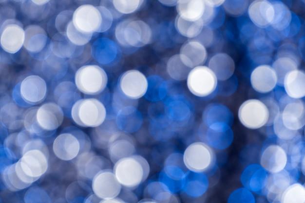Sfondo astratto cerchi bianchi e blu nel bokeh