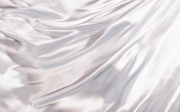 Sfondo astratto bianco seta o tessuto di raso trama