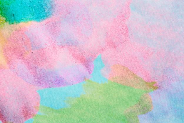 Sfondo astratto con vernice acrilica su tela, sfondo grunge con spazio per testo o immagine, macchie di pittura ad acquerello, struttura luminosa colorata.
