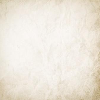 Fondo in bianco astratto per progettazione, struttura di carta beige chiaro del grunge, vecchio materiale