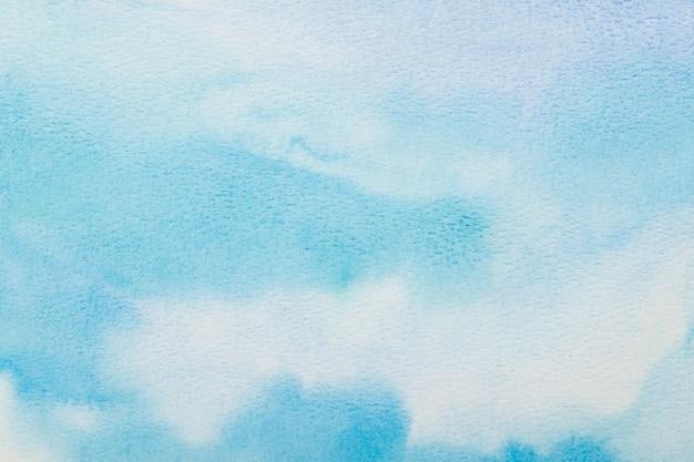 Priorità bassa blu astratta dell'acquerello. il colore che spruzza sulla carta. disegnato a mano.