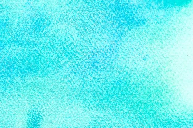 Acquerello blu astratto su fondo bianco il colore che spruzza nella carta è disegnato a mano.