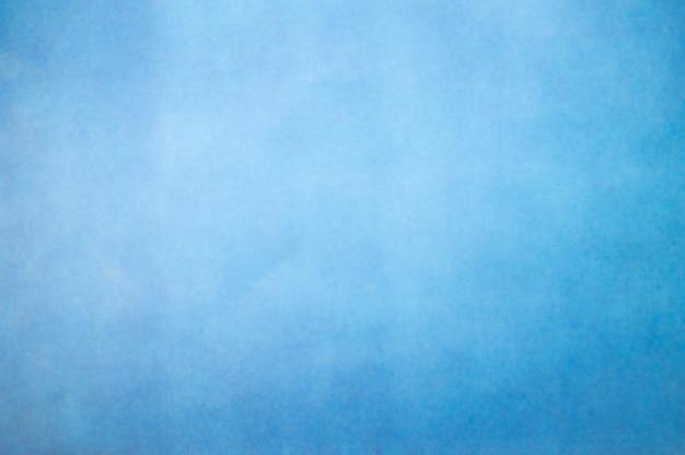 Blu astratto della sfuocatura con la luce sotto il fondo di struttura dell'acqua