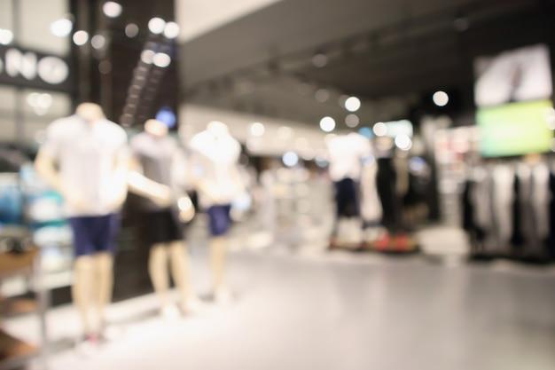 Sfuocatura astratta boutique di abbigliamento display interno del centro commerciale