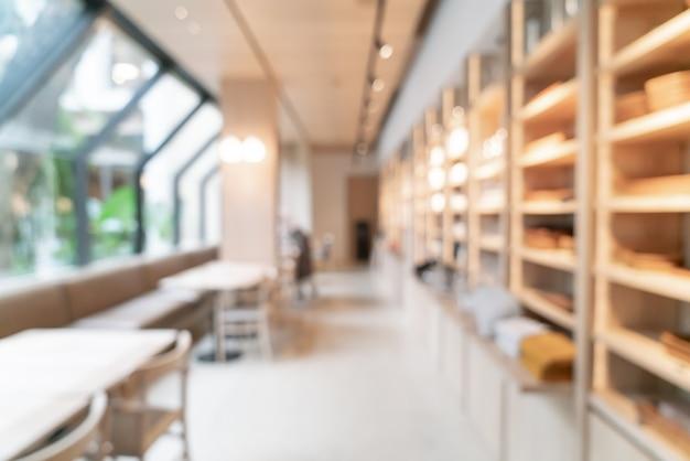 Sfocatura astratta caffetteria caffetteria e ristorante per tavolo con copia spazio