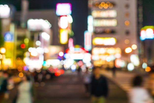 Sfocatura astratta folla persone al mercato di strada di osaka