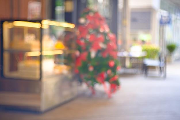 Sfocatura astratta e sfocatura interna caffetteria o ristorante per lo sfondo.
