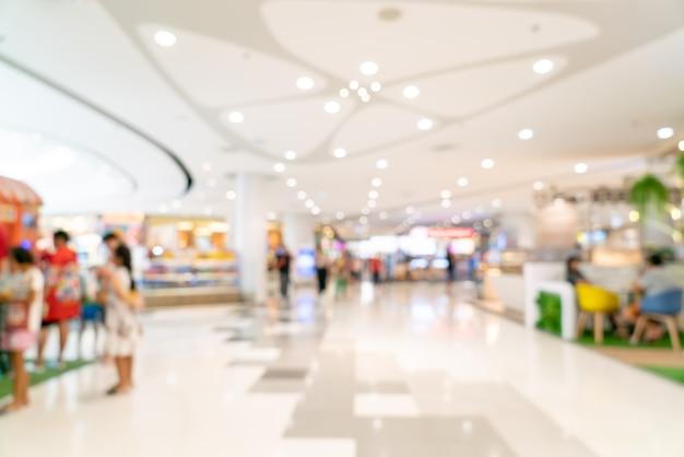 Sfuocatura astratta e centro commerciale sfocato o interno di grandi magazzini