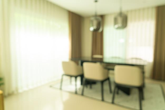 Tavolo da pranzo sfocato astratto a casa per lo sfondo