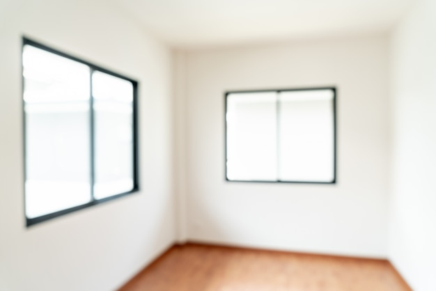 Sfocatura astratta stanza vuota con finestra e porta in casa