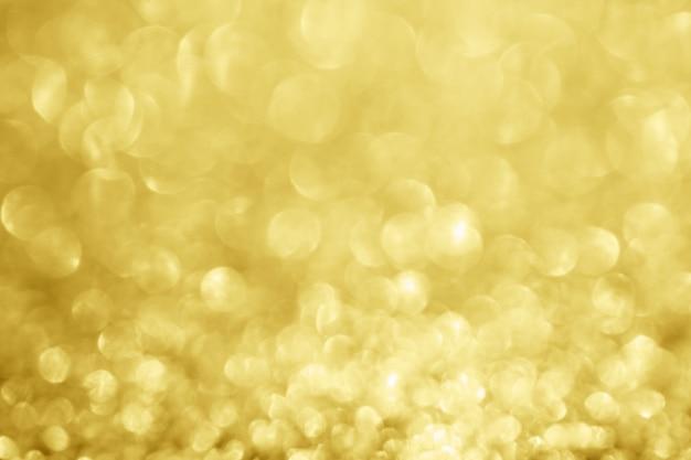 Sfocatura astratta glitter oro sparkle bokeh sfocato sfondo chiaro