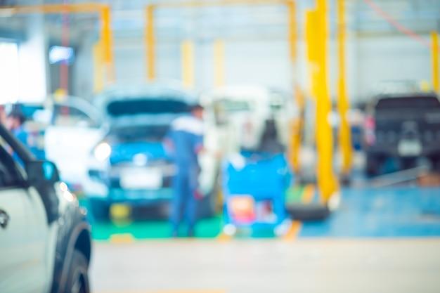 Immagine astratta della sfuocatura del centro di servizio di riparazione auto
