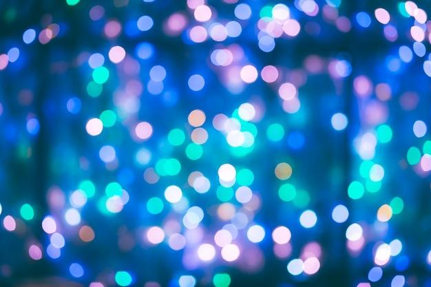 Sfocatura astratta lampadina bokeh sfondo, inverno e concetto di illuminazione natalizia