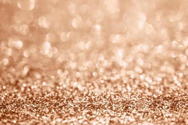 Sfocatura astratta glitter oro rosa sparkle bokeh sfocato sfondo chiaro