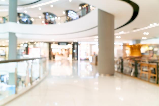 Interno astratto del centro commerciale o del grande magazzino della sfuocatura per fondo