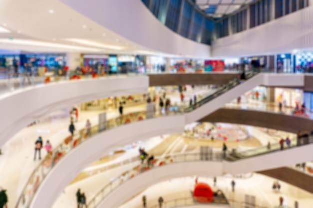 Centro commerciale astratto della sfuocatura dell'interno del grande magazzino per fondo