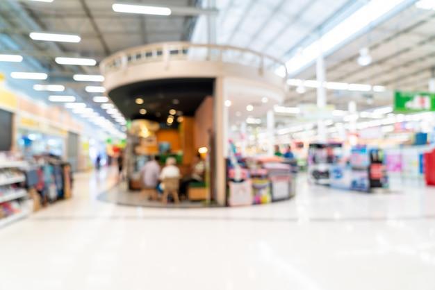 Sfocatura astratta in supermercato per lo sfondo