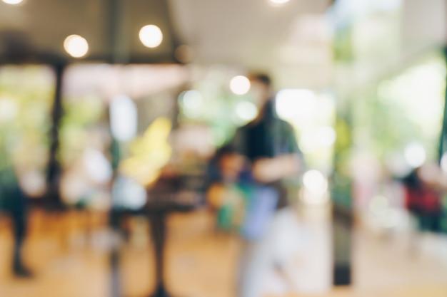 Tavolo luminoso sfocato astratto nella caffetteria e nella caffetteria con sfondo bokeh. modello di visualizzazione del prodotto.