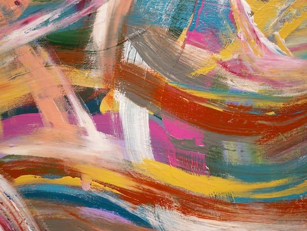 Spruzzi artistici di colori luminosi astratti, struttura della spazzola, frammento di pittura acrilica su tela.