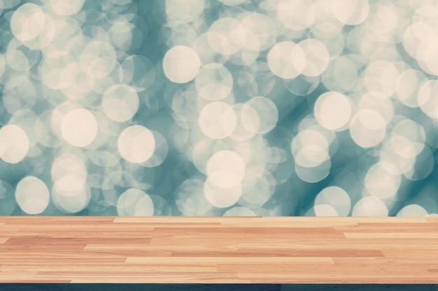 Astratto circolare boken nigth e tavolo di legno con spazio
