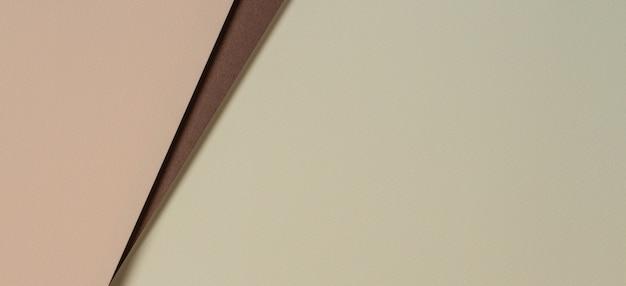 Fondo astratto della composizione nella geometria delle carte di colore con toni gialli, beige e marroni