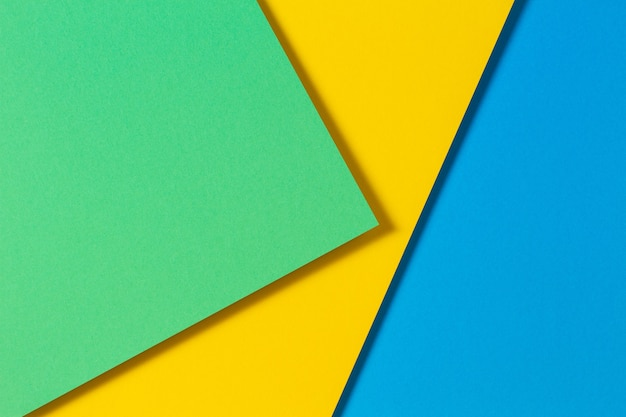 Carte a colori astratte geometria piana composizione laica sfondo con tonalità di colore blu giallo e verde