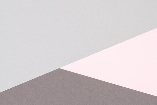 Sfondo astratto carta colorata. forme geometriche e linee nei colori rosa pastello e grigio chiaro