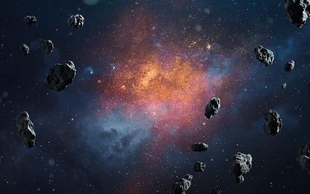 Fondo cosmico astratto con asteroidi e stelle luminose. immagine dello spazio profondo, fantasy di fantascienza in alta risoluzione ideale per carta da parati e stampa. elementi di questa immagine forniti dalla nasa