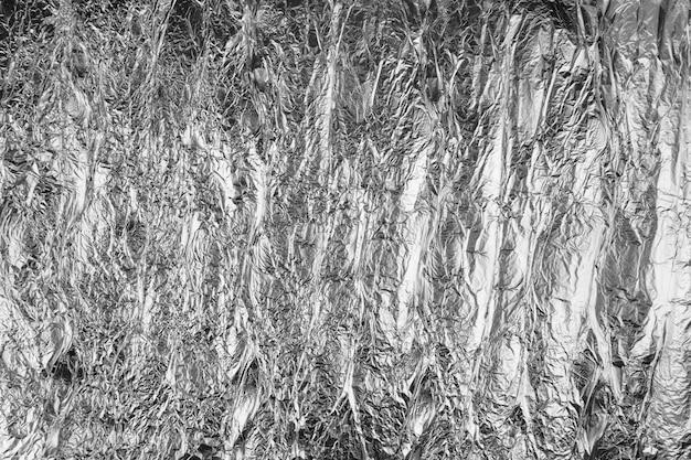 Foglio sgualcito astratto. foto di grunge. il colore grigio definitivo dell'anno 2021