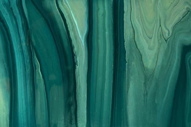 Astratto arte fluida sfondo verde scuro e colori glitter oliva. marmo liquido. dipinto acrilico su tela con sfumatura smeraldo. sfondo acquerello con motivo ondulato. sezione di pietra.