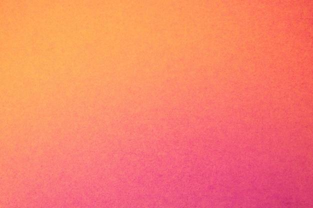 Fondo di struttura di carta arancione di colore pieno astratto