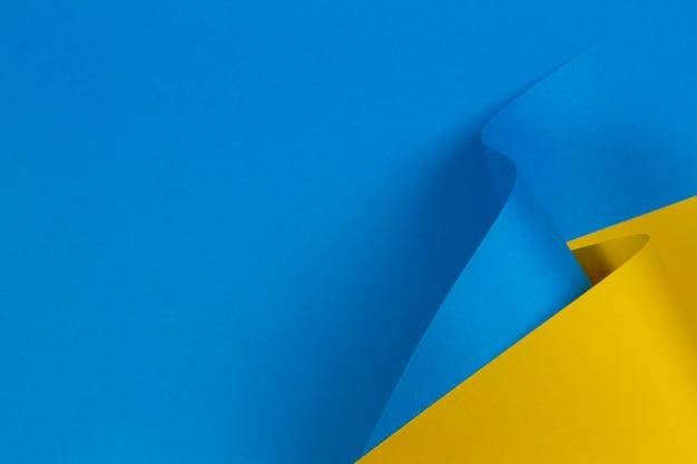 Parete di carta di colore blu e giallo pastello di forma geometrica astratta