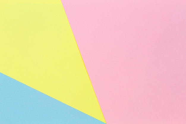 Fondo di carta di colore rosa e blu giallo pastello di forma geometrica astratta