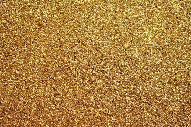 Fondo astratto della scintilla di scintillio dell'oro