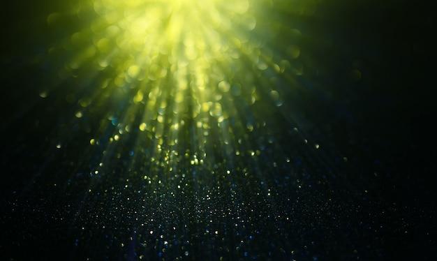 Luci glitter verdi astratte su sfondo sfocato