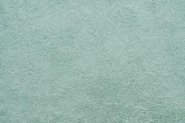 Fondo astratto di struttura del tessuto dell'annata verde