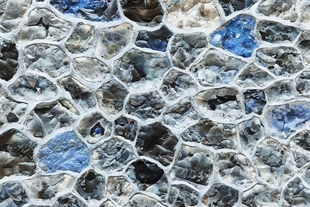 Struttura grigia astratta del muro di pietra del grunge