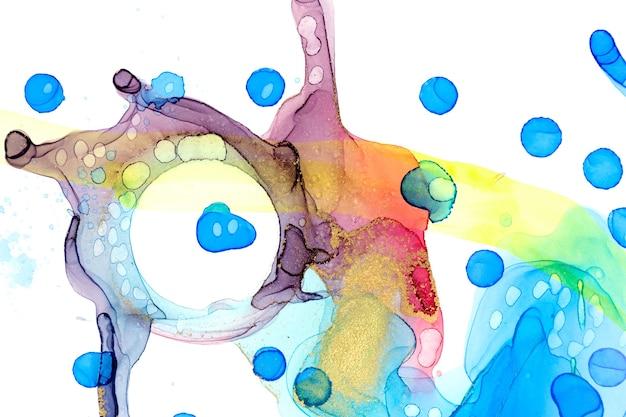 L'inchiostro astratto blu giallo e rosso dell'acquerello macchia l'inchiostro dell'alcool del fondo