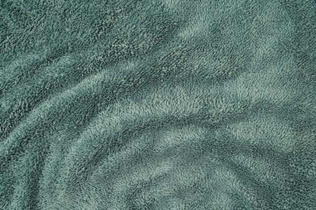 Priorità bassa di struttura del tessuto lanuginoso vintage macro verde astratto